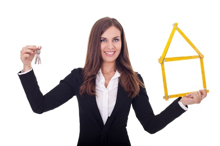 leadership key:  smiling businesswoman giving   keys to new home, isolated on white background