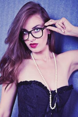 sexy teacher: sexy woman posing in black corset on gray background  Stock Photo