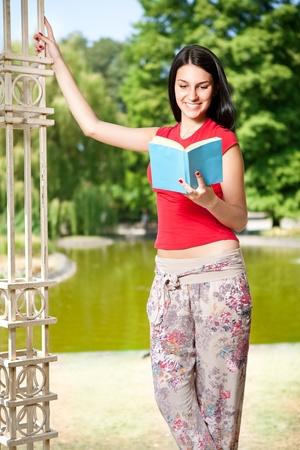 beauty student girl reading book in her garden photo