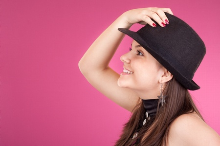 portrait of beautiful dancing girl with hat photo