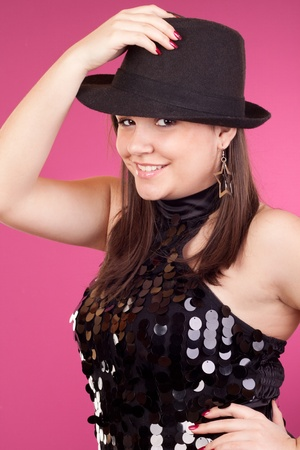 attractive young girl dancing with black hat photo