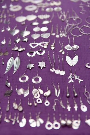Collection of earrings,  jewelry set on violet background photo