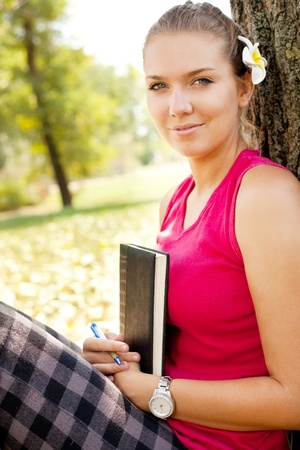 studding:  portrait of cute student girl outdoor