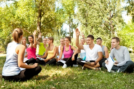 university students having lesson in nature, teacher asks questions  Stock Photo - 10702867