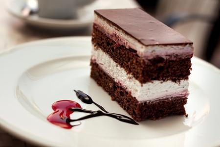 custard slices: piece of tasty chocolate cake on plate