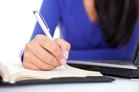 females hand making note,  (hand with pen in focus) Stock Photo - 10686533