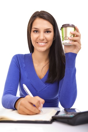 young girl sitting at her work desk and holding coffee, isolated on white background photo