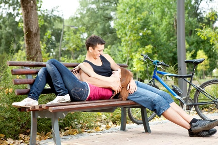 young couple having a great time in park Stock Photo - 10693470