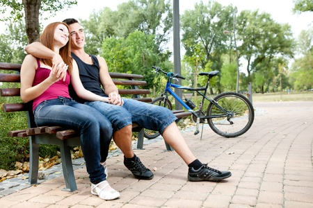 young loving couple relaxing in park Stock Photo - 10693414