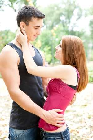 tender love,  young couple in park  photo