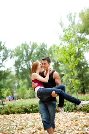 happy couple having fun in park photo