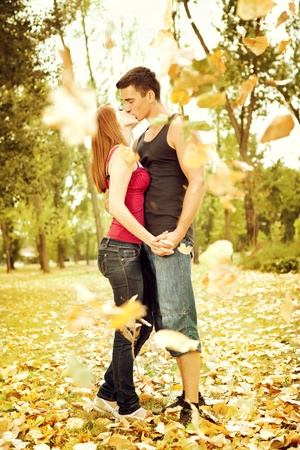full body portrait of an attractive couple in autumn park  Stock Photo