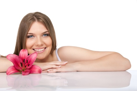 flower close up: smiling , spa girl with big pink flower, isolated on white background