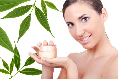 young beauty woman showing cream for body Stock Photo - 10686127