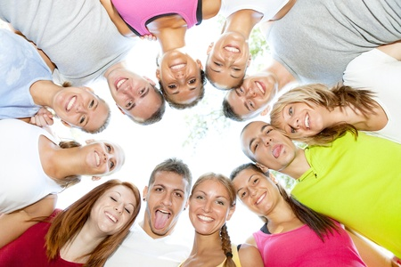 circle of friends:  group of young people smiling and holding heads together