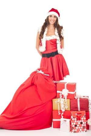 beautiful girl in santa claus suit with big gift bag and lot of presents, isolated photo