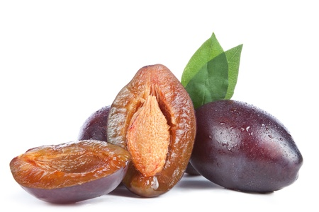 plums and leaves,  isolated on a white background photo