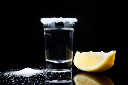 tequila:  tequila shot, with lemon and salt close up on black background