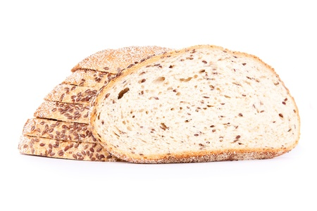 slice of flax bred with loaf in background, isolated photo