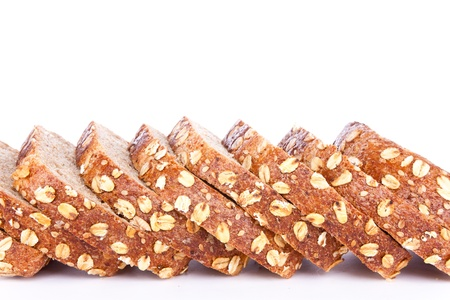 slices of bran bread, isolated on white background photo