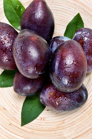 freshness plums on plate photo
