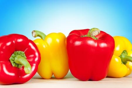 glister: fresh sweet paprika on blue background Stock Photo