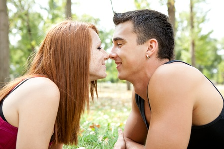 young couple in park having romantic time photo