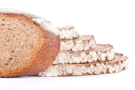 fresh, home-made brown bread, isolated on white background photo
