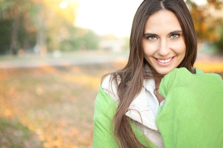 young, smiling woman  in nature , autumn park  photo
