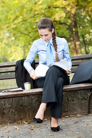 businesswoman working in park on break