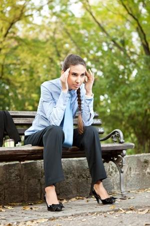 having a break: businesswoman with headache Stock Photo