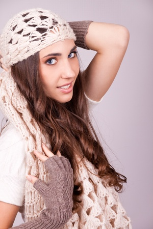 Young woman wearing a scarf and autumn clothing photo