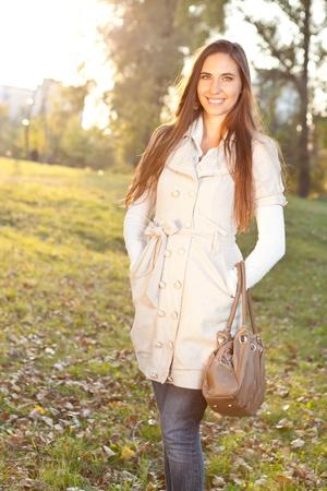 Young beautiful woman wearing  autumn  clothing photo