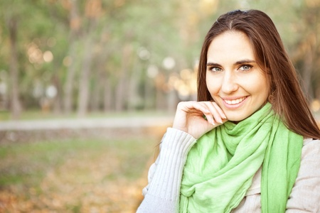 smiling woman with autumn park in background photo