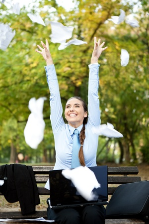 throw paper: happiness businesswoman throwing paper in the air, outdoor