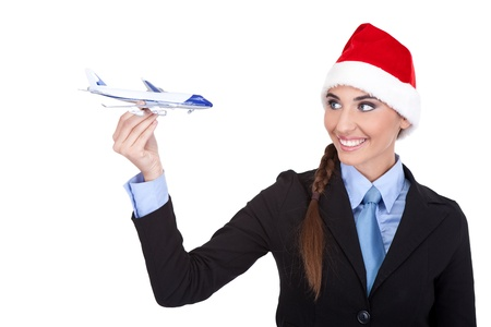 corporate travel:  santa stewardess with  plane, travel with us for the holidays,  isolated on white background Stock Photo