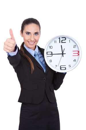 save time: businesswoman holding clock and shoving sign ok Stock Photo