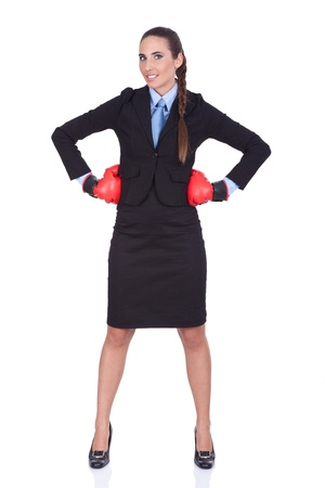 aggressive people:  Businesswoman standing with boxing gloves ready for the competition, isolated on white background Stock Photo