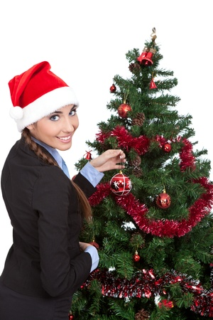 young smiling woman  decorate christmas tree, isolated on white background photo