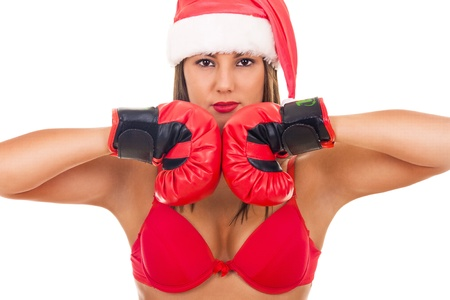 big breast woman: close up, sexy girl in bra with santa hat and boxing gloves, isolated on white Stock Photo