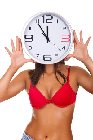 young naked woman holding clock on face on white background photo