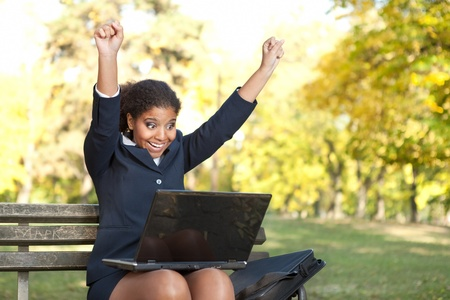 afro businesswoman with raised arms, success  with her work Stock Photo - 11270938