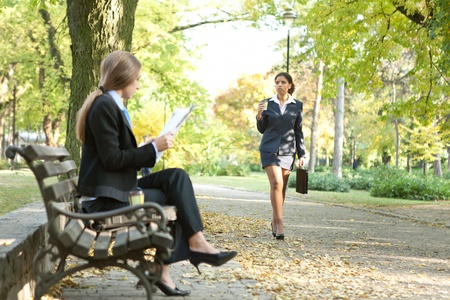 free time: Businesspeople in city park on break
