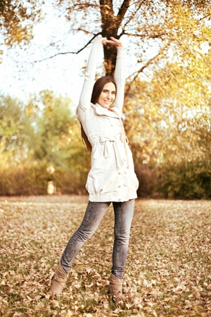 young woman in a morning walk in the park outstretching  photo