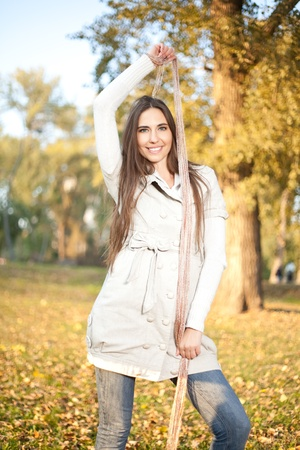Young beautiful woman in autumn park photo