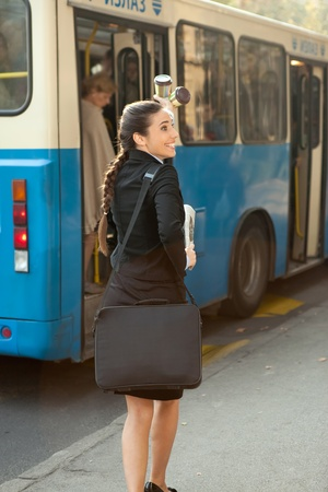 bus station: business woman travelling on public transport