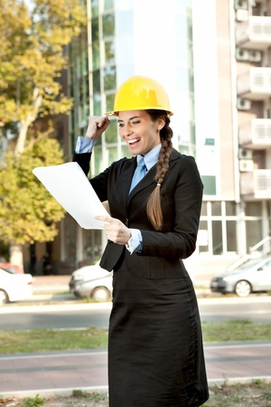 happiness  female architect, looking in document with good news  photo