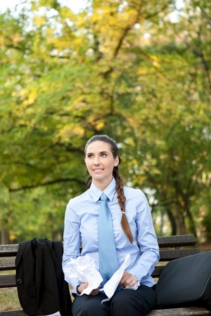 young businesswoman working  with paper in park Stock Photo - 11505971
