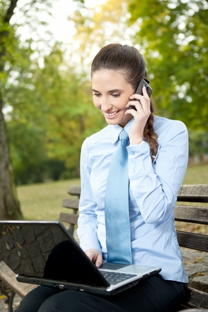 modern, young businesswoman using technology for working , outdoor Stock Photo - 11506014