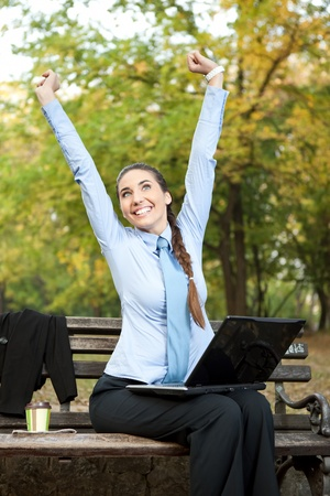 happiness businesswoman celebration her success, hands up photo